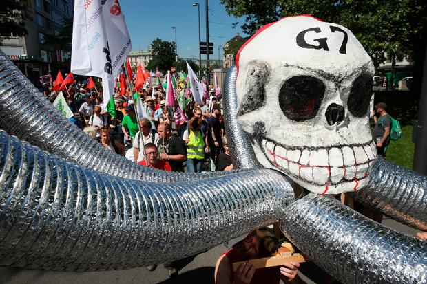 People demonstrating against the upcoming G7 summit gather for a protest march on June 4, 2015 in Munich, Germany. The leaders of the G7 nations are scheduled to meet at nearby Schloss Elmau June 7-8. (Photo by Sean Gallup/Getty Images)