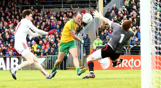 Hitting the heights: Donegal's Colm McFadden fires in a shot during the cracking Ulster encounter with Tyrone