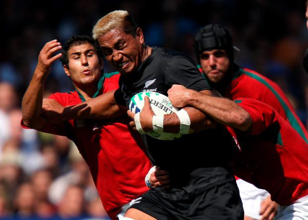 New Zealand's Jerry Collins breaks through the Portugal defence during the IRB World Cup match. Collins has been remembered as the epitome of a rugby player and an All Black as tributes poured in following the death of the former New Zealand forward. Photo: David Davies/PA