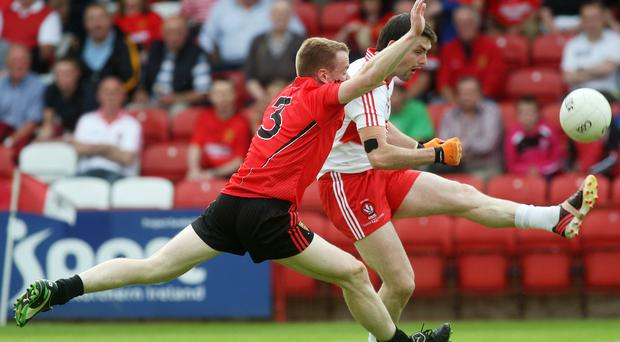 Derry's Eoin Bradley and Down's Brendan McArdle