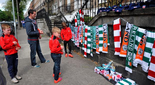 Football fans view merchandise ahead of the international friendly football match between the Republic of Ireland vs England at the Aviva Stadium in Dublin. Barry Cronin/PA Wire.