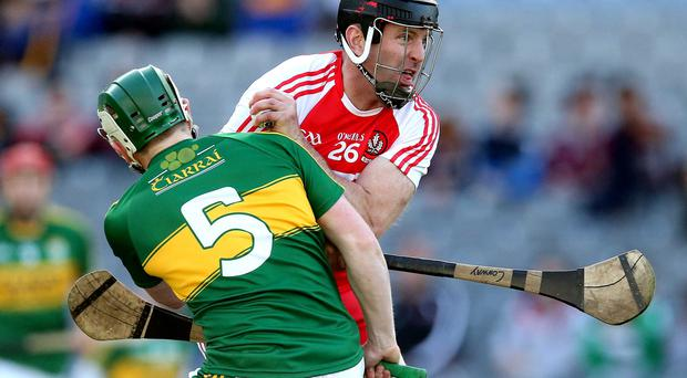 Heat of battle: Kerry's Daniel Collins challenges with Michael Conway of Derry