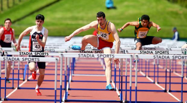 On the run: Ben Reynolds safely negotiates an obstacle on his way to winning the 110m hurdles at the Mary Peters Track
