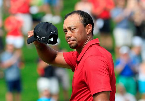 Sinking feeling: Tiger Woods had a bad weekend as he struggles to find his form ahead of the US Open