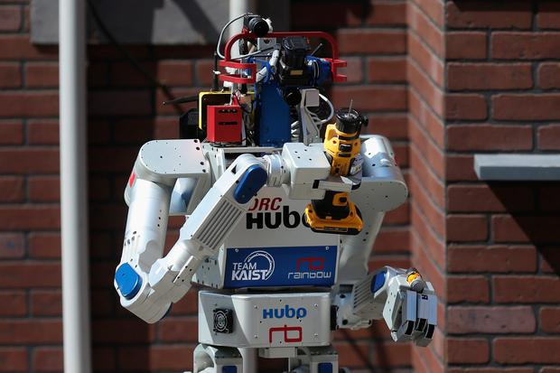Winner: Team Kaist's DRC-HUBO robot successfully uses a power hand tool during its successful final run in the Defense Advanced Research Projects Agency (DARPA) Robotics Challenge at the Fairplex June 6, 2015 in Pomona, California. (Photo by Chip Somodevilla/Getty Images)