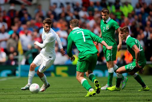 England's Adam Lallana under pressure from the Republic of Ireland team during the international friendly at The Aviva Stadium.
