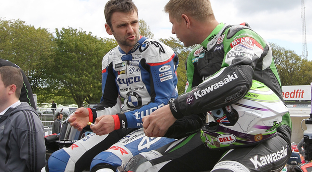 William Dunlop chats with Gary Johnson before the start of practice at the Isle of Man TT today. The Ballymoney man crashed on the Laurel Bank section of the course and was taken to hospital by helicopter with suspected chest injuries. PACEMAKER, BELFAST, 8/6/2015: PICTURE BY STEPHEN DAVISON