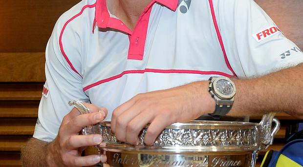 Switzerland's Stan Wawrinka poses with the cup in the cloakroom of the stadium after winning the French Open tennis tournament against Serbia's Novak Djokovic, at the Roland Garros stadium, Sunday, June 7, 2015 in Paris. (Christophe Saidi, FFT, Pool via AP)