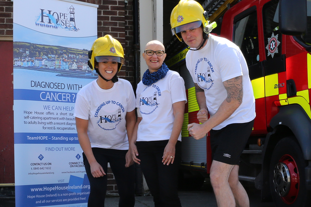 Northern Ireland Fire & Rescue Service Firefighters Kirsty Breen and Warren Campbell with Hope House charity Fundraising Manager Dawn McConnell get ready for the 26 Hour Treadmill Challenge at Cadogan Fire Station, Belfast on Friday 19th June.