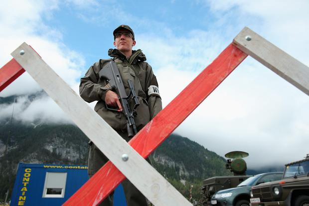 Bilderberg 2015: George Osborne and Ed Balls will rub shoulders with former MI6 chief Sir John Sawers and Google boss Eric Schmidt. Above: A soldier of the Austrian army stands at a mobile radar station (Photo by Sean Gallup/Getty Images)