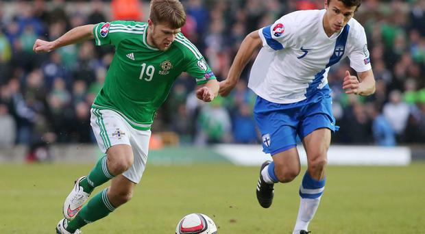 Surging forward: Jamie Ward, pictured taking on Finland, has recently proved a key component of Northern Ireland's attack