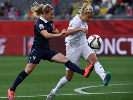 Closing in: England's Steph Houghton is put under pressure from Eugenie Le Sommer