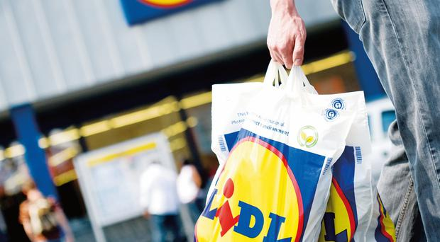 Lidl has continued its rapid rise in the Northern Ireland grocery market as it eats into the dominance of Tesco and Sainsbury's