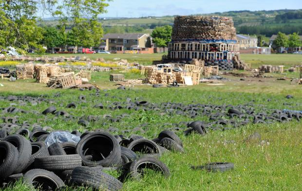 Tyres surrounding the bonfire at New Mossley yesterday