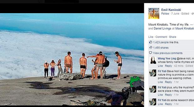 Screen grab taken from the Facebook page of Emil Kaminski showing tourists allegedly posing naked on top of Mount Kinabalu in Malaysia, as British woman Eleanor Hawkins and four other westerners have been arrested in Malaysia for allegedly posing naked on top of the sacred mountain. Emil Kaminski/Facebook/PA Wire