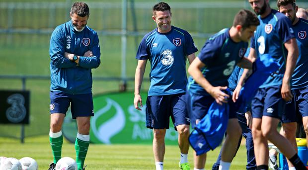 United: Roy Keane and Robbie Keane enjoy a lighter moment during training at Malahide