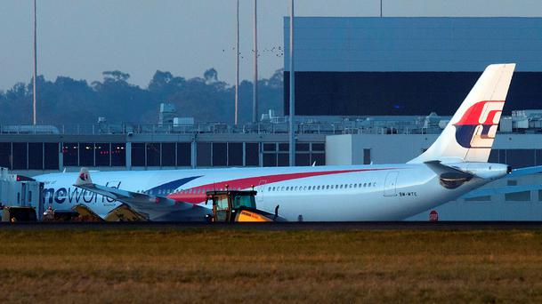 A Malaysia Airlines Airbus A330 passenger aircraft is seen following an emergency landing at the Melbourne international airport on June 12, 2015.