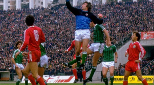First to the punch: Pat Jennings clears the danger during Northern Ireland's 1-0 victory in Bucharest in 1985