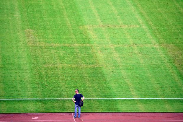 A man looks at the pitch appearing to show the pattern of a swastika following the the Euro 2016 qualifying football match between Croatia and Italy at the Poljud stadium in Split on June 12, 2015. AFP PHOTO / ANDREJ ISAKOVICANDREJ ISAKOVIC/AFP/Getty Images