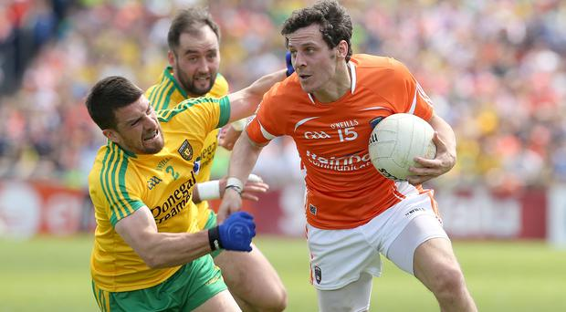 Surging forward: Armagh's Jamie Clarke aims to find a way past Paddy McGrath at the Athletic Grounds