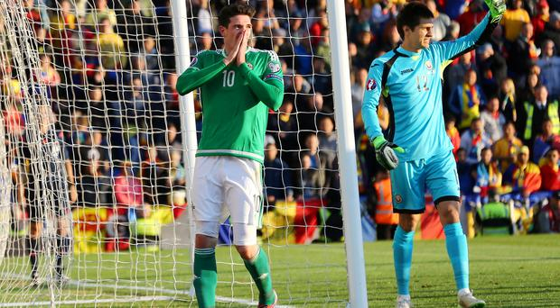 Missed opportunity: Kyle Lafferty can't believe it as a chance goes begging against Romania at Windsor