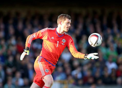 Solid: Michael McGovern had a fine game as he kept a clean sheet against Romania on his competitive international debut