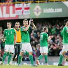 Skipper Steven Davis leads the Northern Ireland team as they hail the GAWA after the 0-0 draw against Romania