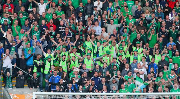 Simply fantastic: Northern Ireland supporters roar on their team from the brand new East Stand against Romania on Saturday night