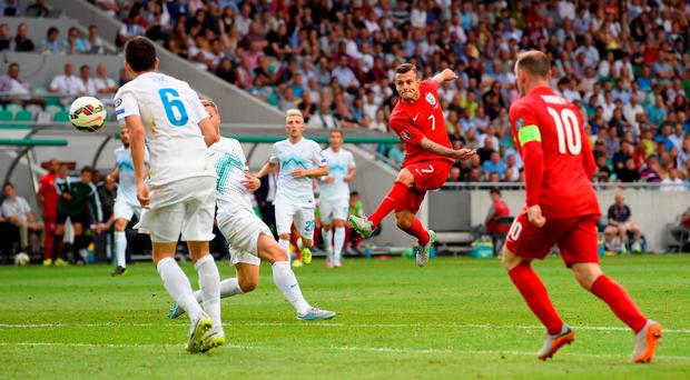 Clinical finish: Midfielder Jack Wilshere scores England's second goal against Slovenia in Ljubljana