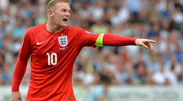 Lift it: Wayne Rooney barks out orders against Slovenia