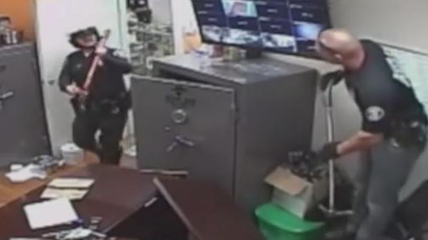 Santa Ana cops at the Sky High Holistic store attempt to disable the surveillance equipment