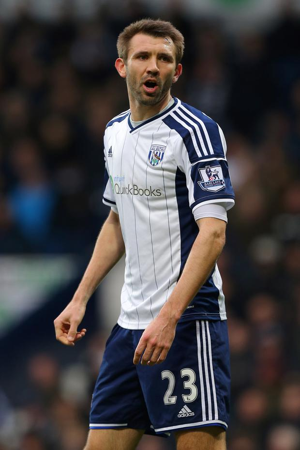 Staying put: Gareth McAuley has committed to West Brom