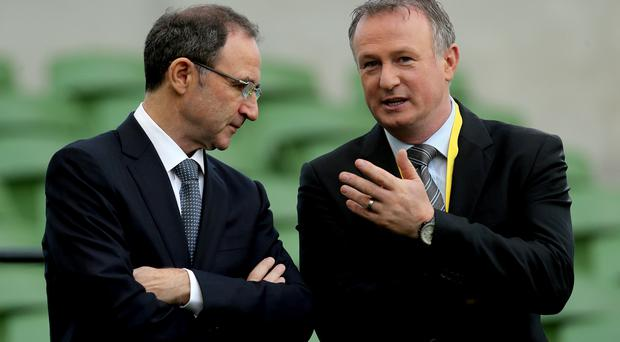 Differing fortunes: Martin and Michael O'Neill have a chat