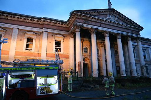 Monday 15th June 2015 - Crumlin Road Court Fire Pictured is firefighters at the scene of a fire at the Crumlin Road Court house in Belfast at around 9:30pm on Monday Night. Picture - Kevin Scott / Presseye