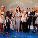 Our four winners: L-R Oliver Dickey, Jay Beatty, Danielle McGriskin and Patricia Nevines. Pictured with Tony McGinn of Specsavers, Louis Wlash and Sunday Life editor Martin Breen. Pic: Kelvin Boyes/Press Eye.