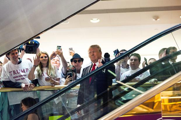 Business mogul Donald Trump rides an escalator to a press event to announce his candidacy for the US presidency at Trump Tower (Photo by Christopher Gregory/Getty Images)