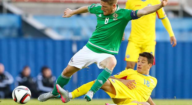 Feeling positive: Steven Davis is optimistic about reaching France next summer after the 0-0 draw with Romania