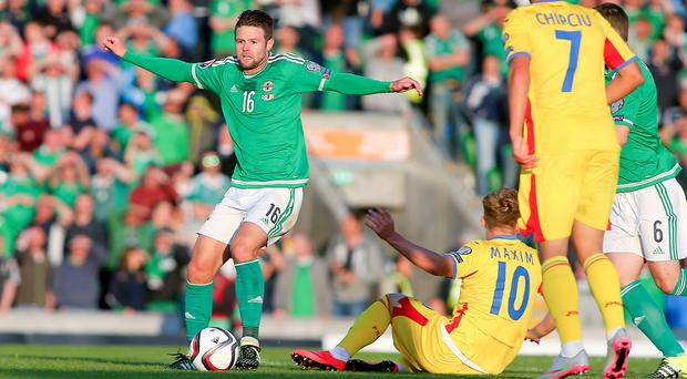 On the ball: Oliver Norwood went close against Romania