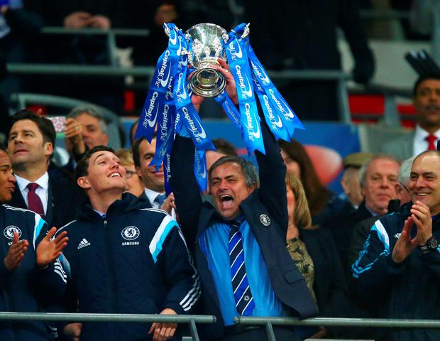 Manager Jose Mourinho of Chelsea lifts the trophy during the Capital One Cup Final match between Chelsea and Tottenham Hotspur at Wembley Stadium.