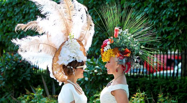 Anna Mott (right) and another racegoer show off their hats during Ladies Day, on day three of the 2015 Royal Ascot Meeting at Ascot Racecourse, Berkshire.