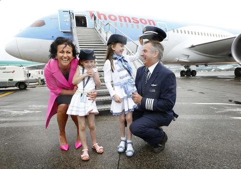 Captain John Murphy, Managing Director of Thomson Airways with Chris Browne, Chief Operations Officer TUI Aviation and Chris's niece's Charlotte Grieves, age 7 and Victoria Grieves, age 5 pictured outside the Thomson 787 Dreamliner as the aircraft touched down on Irish soil for the very first time this morning to celebrate the launch of two long-haul routes to Cancun, Mexico and Montego Bay, Jamaica direct from Dublin Airport during summer 2016.