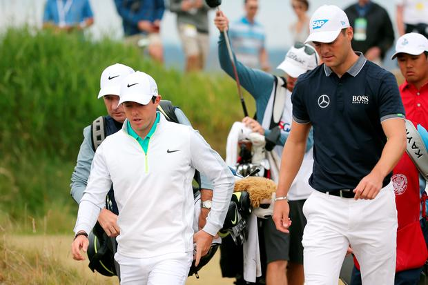 Rory McIlroy of Northern Ireland walks with Martin Kaymer of Germany on the 11th hole during the first round of the 115th U.S. Open Championship at Chambers Bay on June 18, 2015 in University Place, Washington. (Photo by Mike Ehrmann/Getty Images)