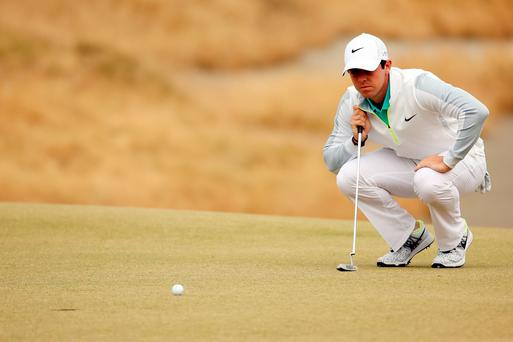 Feeling the strain: Rory McIlroy shows his frustration during the opening round of the US Open