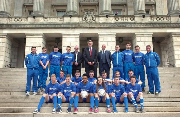 Stormont to the States: Councillor Dermot Nichol, Education Minister John O'Dowd and David Campbell with the students who will travel to America and Canada