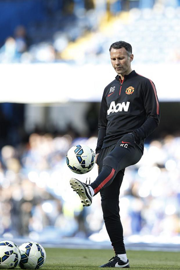 Balancing act: Ryan Giggs admitted there are differences between being a player and a coach
