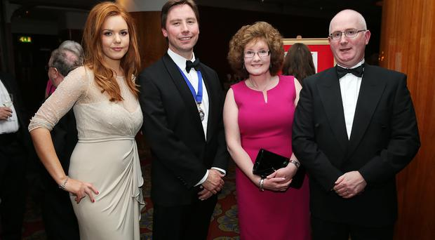 Press Eye - Belfast - Northern Ireland - 14th June 2015 - Richard and Marina Stack are pictured with Con and Paul O'Neill at the Chartered Institute of Managment Accountants Northern Ireland 2015 annual dinner in the Europa Hotel. Picture by Kelvin Boyes / Press Eye.