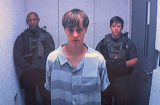 Dylann Roof appears via video before a judge in Charleston, S.C., on Friday, June 19, 2015. (Centralized Bond Hearing Court, of Charleston, S.C. via AP)