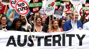 Demonstrators including Labour MP Diane Abbott (2L), British singer Charlotte Church (C) and General Secretary of Unite Len McCluskey (2) hold a banner as they march to protest against the British government's spending cuts and austerity measures in London on June 20, 2015. The national demonstration against austerity was organised by People's Assembly against government spending cuts. AFP PHOTO / JUSTIN TALLISJUSTIN TALLIS/AFP/Getty Images