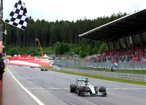 Easy does it: Nico Rosberg cruises to victory in Austria, with Lewis Hamilton behind him