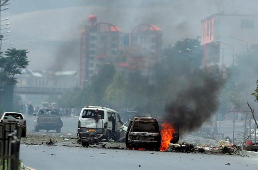Fire and smokes rise at the site of a suicide attack during clashes with Taliban fighters in front of the Parliament, in Kabul, Afghanistan, Monday, June 22, 2015.